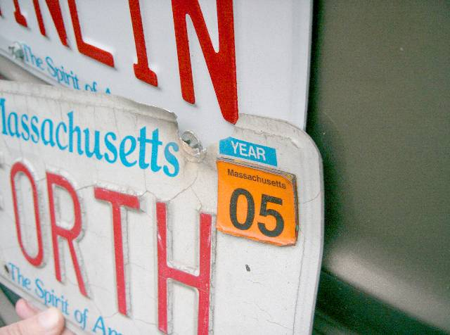 Old FORTH plate, with decades of annual tags